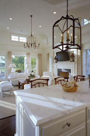 Traditional Dining Room with Hardwood floors, Paint 1, Carrara white marble, can lights, Chandelier, Cathedral ceiling