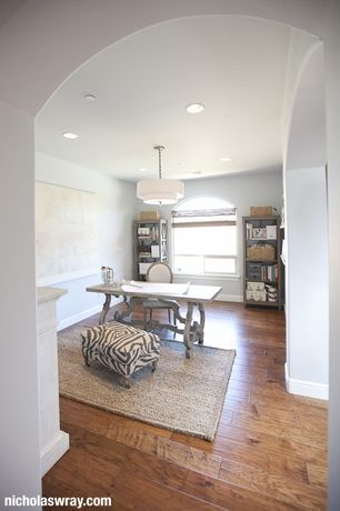 Contemporary Home Office with Hardwood floors, flush light, Arched window