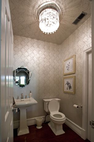 Traditional Powder Room with specialty door, Pedestal sink, Laminate floors, flush light, interior wallpaper, Powder room