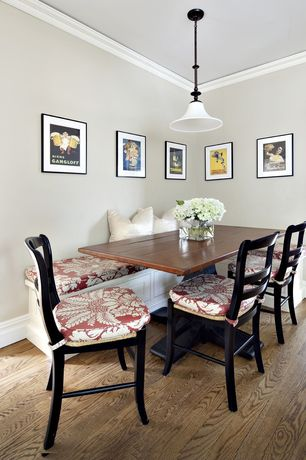 Cottage Dining Room with Hardwood floors, Pendant light, Crown molding