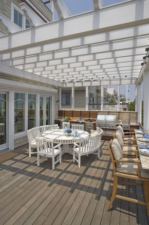 Traditional Deck with Trellis, picture window, Deck Railing, sliding glass door, Outdoor kitchen