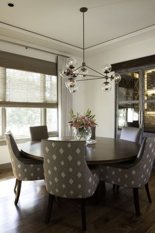 Contemporary Dining Room with Recessed ceiling, Round dining table, Upholstered dining chair, Hardwood floors