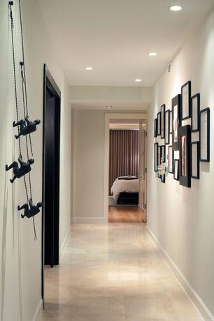 Modern Hallway with travertine tile floors, Rock Climbing Wall Metalart Sculpture, specialty door