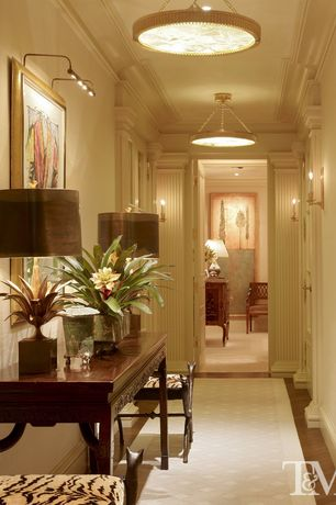 Traditional Hallway with Standard height, Laminate floors, six panel door, Crown molding, Wall sconce, flush light