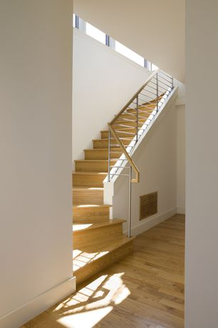 Contemporary Staircase with Hardwood floors