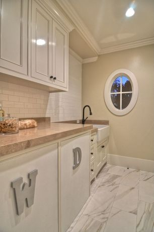 Traditional Laundry Room with Subway tile backsplash, High ceiling, Custom cabinetry, Farmhouse sink, Crown molding
