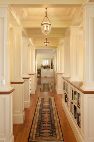 Traditional Hallway with Box ceiling, Built-in bookshelf, Columns, Hardwood floors, High ceiling, Pendant light