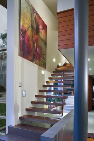 Contemporary Staircase with Wood panel wall, Floating staircase