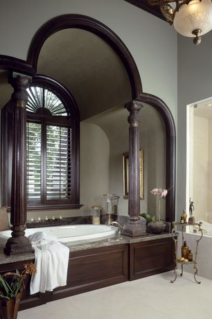 Traditional Master Bathroom with can lights, flush light, Granite tub deck, Wood shutters, Shower, Paint 1, drop in bathtub