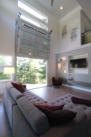 Contemporary Great Room with specialty door, Laminate floors, Sectional l-shaped couch, Loft, High ceiling, Ceiling fan