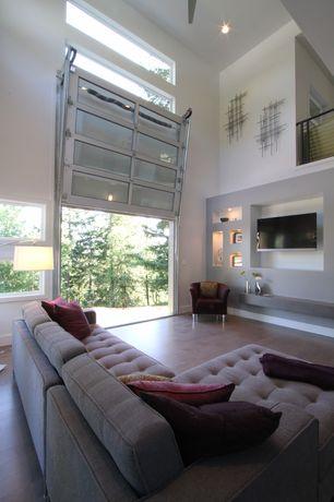 Contemporary Great Room with Vertical lift garage door, Laminate floors, specialty door, Loft, High ceiling, Ceiling fan