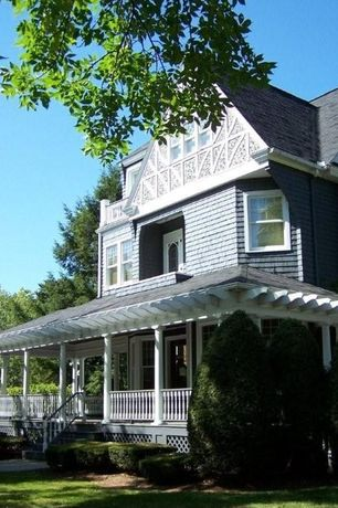 Traditional Exterior of Home with Outdoor balcony, Wrap around porch, Paint 1, Painted shingle siding