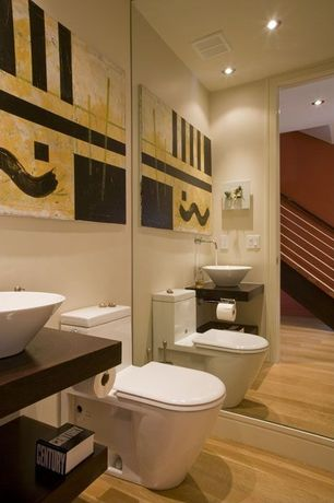 Contemporary Powder Room with Standard height, can lights, Laminate floors, Wood counters, Vessel sink, Powder room