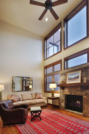 Contemporary Living Room with Ceiling fan, Hardwood floors, High ceiling, stone fireplace