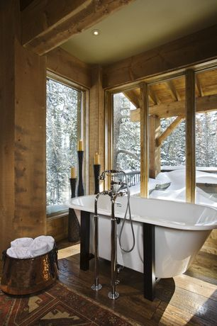 Rustic Master Bathroom with Kingston brass victorian center deck claw foot mixer faucet clawfoot tub and shower filler