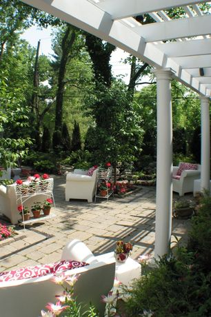 Traditional Patio with exterior stone floors, Wooden pillar open ceiling canopy, Raised beds, Kartell bubble chair, Trellis