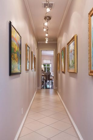 Traditional Hallway with can lights, Crown molding, Standard height, Concrete tile
