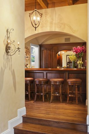 Traditional Bar with flush light, Wall sconce, Exposed beam, High ceiling, Hardwood floors, Mural