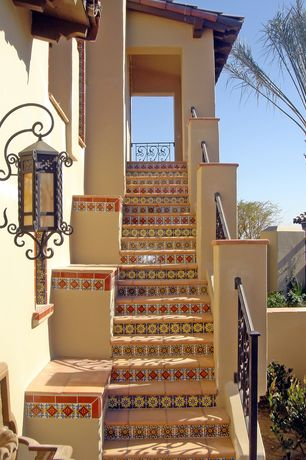 Mediterranean Staircase with Wrought iron railing, Tiled stair risers, Exterior stucco, Talavera tile