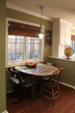 Country Dining Room with Standard height, Laminate floors, Pendant light, Crown molding, Casement