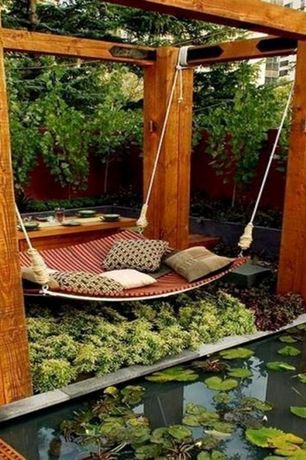 Asian Landscape/Yard with Pond, Koi pond, Custom Hammock-Daybed by Jamie Durie, Trellis, Garden water feature, Fence