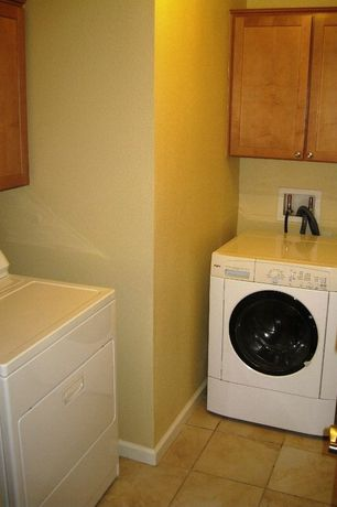 Craftsman Laundry Room with limestone tile floors, Built-in bookshelf