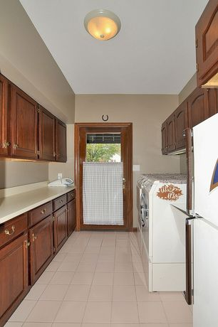 Craftsman Laundry Room with flush light, laundry sink, Built-in bookshelf, drop-in sink, Standard height