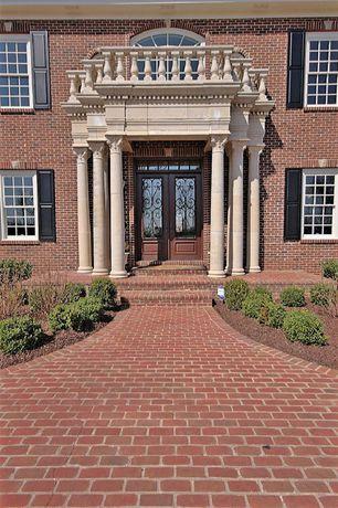 Traditional Front Door with Raised beds, Transom window, exterior brick floors, Glass panel door