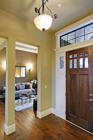 Craftsman Entryway with flush light, Glass panel door, High ceiling, Hardwood floors, Transom window