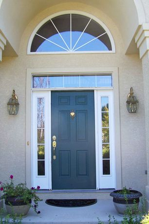 Traditional Front Door with six panel door, Arched window, exterior stone floors, Transom window