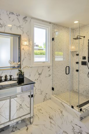 Traditional 3/4 Bathroom with Mirrored And Black Granite Bathroom Sink Vanity, complex marble tile floors, Wall sconce