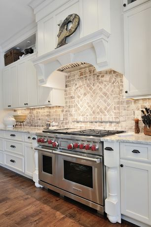 Country Kitchen with Complex granite counters, Bin pull hardware, Matte black traditional cup pull, Hardwood floors, One-wall