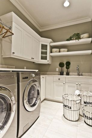 Traditional Laundry Room with Built-in bookshelf, Undermount sink, sandstone tile floors, Crown molding