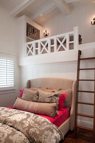 Traditional Kids Bedroom with Italian block print paisley duvet cover, Hardwood floors, Interior plantation shutters, Ladder