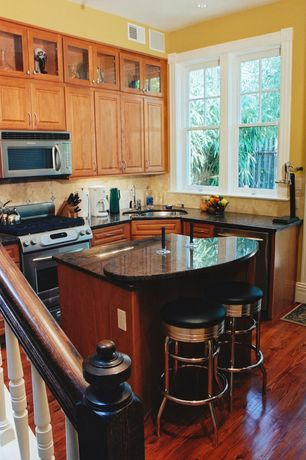 Traditional Kitchen with Simple granite counters, Malaccan cabernet solid hardwood flooring, Raised panel, Limestone Tile