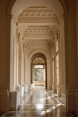 Traditional Hallway with Arched window, High ceiling, Crown molding, French doors, simple marble floors, Box ceiling