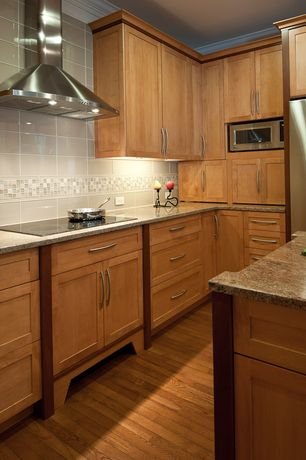Craftsman Kitchen with Flat panel cabinets, Complex granite counters, Ultracraft destiny shaker cabinetry, U-shaped
