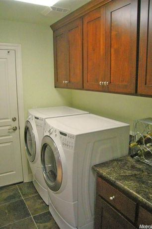 Traditional Laundry Room with laundry sink, flush light, stone tile floors, Built-in bookshelf, specialty door, Drop-in sink