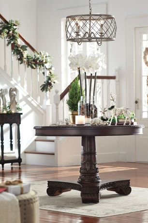 Traditional Entryway with Laminate floors, Paint 1, Standard height, Chandelier, Casement, Glass panel door
