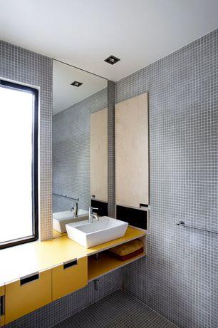 Contemporary Full Bathroom with European Cabinets, ceramic tile floors, Wood counters, Custom Cut Mirror, Vessel sink, Flush