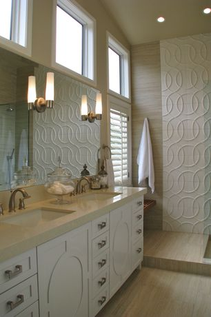 Contemporary Master Bathroom with Flush, Undermount sink, Handheld showerhead, Limestone counters, frameless showerdoor