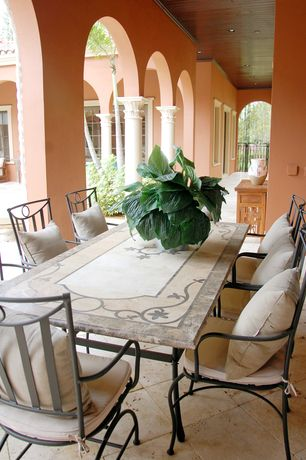 Mediterranean Porch with exterior tile floors, Livingroc.net italian mosaic marble outdoor table, Wrap around porch, Gate