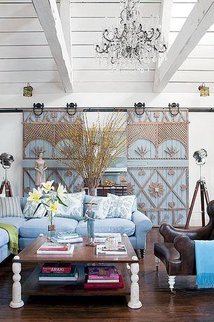 Eclectic Living Room with Chandelier, flush light, Standard height, Barn door, Exposed beam, Hardwood floors