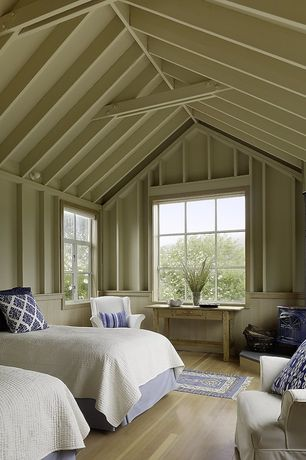 Cottage Guest Bedroom with Vaulted wood ceiling, Hardwood floors, Fireplace, Wood Stove fireplace, Casement, Side table