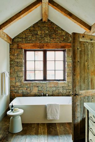 Country Master Bathroom with Freestanding, Bathtub, specialty door, Standard height, Exposed beam, Flush, Master bathroom