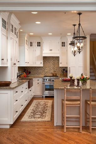 Traditional Kitchen with Subway Tile, Simple granite counters, Inset cabinets, Tumbled travertine mini subway mosaic tile