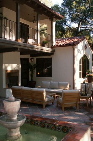 Eclectic Patio with exterior tile floors, Fountain, Tile Roofing Installation Cost Calculator, Arched window
