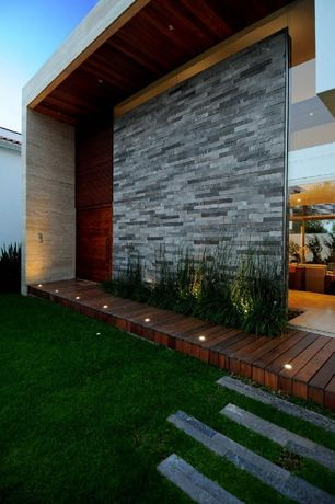 Contemporary Exterior of Home with Fence, Raised beds, Pathway