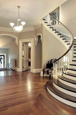 Traditional Entryway with Hardwood floors, Paint 1, Chandelier, Crown molding, Elyse wingback paisley print accent chairs