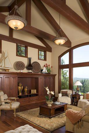 Traditional Living Room with Built-in bookshelf, High ceiling, Exposed beam, Hardwood floors, Pendant light